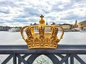 stock photo of crown  - Swedish royal crown on a bridge view over Gamla Stan. Stockholm Sweden.