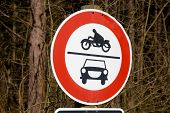 pic of sidecar  - road sign ban of cars and motorcycles in the wood in germany. Ban on motorcycles with sidecars; mopeds and scooters; as well as for cars and other track vehicles.