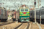 picture of passenger train  - Passenger trains move on the station at day time - JPG