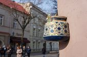 stock photo of teapot  - Ancient teapot embedded in facade of old building in Vilnius - JPG
