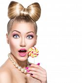picture of lolli  - Beauty fashion model girl Eating colourful lollipop - JPG