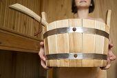 picture of bucket  - Bucket in the hands of women in sauna bath accessories - JPG