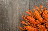 picture of crawfish  - Plate of red crayfishes on old dark wooden table in left - JPG