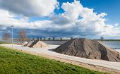 image of sand gravel  - Storage and handling of sand and gravel on the banks of a Dutch river - JPG
