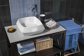 foto of bathroom sink  - detail of a modern bathroom with sink and accessories bathroom cabinet and blue bathroom tiles - JPG