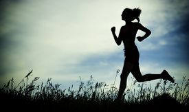 stock photo of sportswear  - Young lady running - JPG