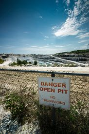 picture of open-pit mine  - A sign reading  - JPG