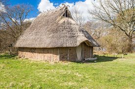 foto of serpent  - Part of viking age village replica in southern Sweden in early spring - JPG