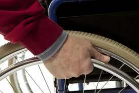 stock photo of crippled  - Wheelchair user makes various movements with his wheelchair - JPG