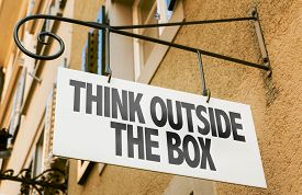 stock photo of thinking outside box  - Think Outside the Box sign in a conceptual image - JPG