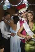 Multi-ethnic prom king and queen dancing poster