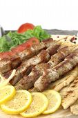 foto of souvlaki  - Plate of traditional Greek porl skewer  - JPG