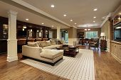 stock photo of basement  - Basement in luxury home with bar area - JPG