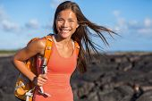 Happy backpacking girl tourist on travel adventure. Young hiking Asian backpacker woman hiker walkin poster