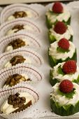 picture of crudites  - Platter filled with small party snacks in a row