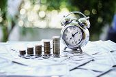 Close Up Of Time And Money With Green Bokeh Background ,business Finance And Money Concept,save Mone poster