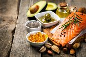 Selection Of Healthy Unsaturated Fats, Omega 3 - Fish, Avocado, Olives, Nuts And Seeds poster