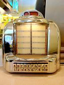 stock photo of jukebox  - Jukebox in a Fifties Style Diner with all branding removed - JPG