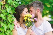 Secret Romantic Kiss. Love Romantic Feelings. Moment Of Intimacy. Couple In Love Hiding Behind Bouqu poster