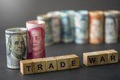 China And Usa Trade War Wording On Wooden Cubes With Us Dollar And Yuan Banknote On Black Background poster