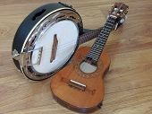 Two Brazilian String Musical Instruments: Cavaquinho And Samba Banjo On A Wooden Surface. They Are W poster
