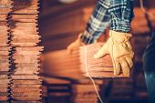 Raw Hardwood Flooring Panels Moving By Caucasian Worker. Woodwork Industry. poster