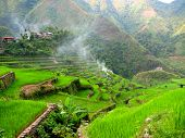 stock photo of ifugao  - Top left shows a small village perched upon a descending staircase of rice terraces - JPG