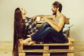 Young Happy Couple Of Pretty Girl Or Cute Woman, With Brunette Long Hair And Handsome Man Or Muscula poster