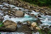 Mountain River Rages On Rocks On A Cloudy Day poster