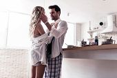Dark-haired Bearded Man In A White Shirt Touching Tenderly His Wifes Face poster