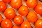 Fresh Ripe Persimmons In Market. Persimmons Background. poster