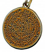 Vintage mystery amulet from old metal isolated on white background