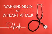 Inscription Warning Signs Of A Heart Attack And Stethoscope On Red Background, Top View poster