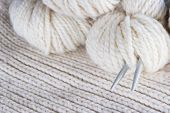 craft background - knitting, wool, needles