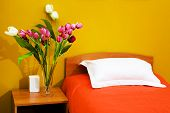 Bed With An Orange Coverlet