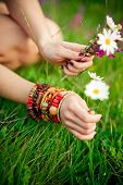Hand With Armlet Picking Wild Flowers.