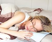 Exhausted Woman Sleeping In Her Glasses