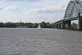 Sailboat Sailing Under a Bridge