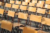 wooden chairs aligned at outdoor school event
