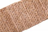 stock photo of wasa bread  - Close up of a crispbread with sesame seeds isolated on white selective focus  - JPG