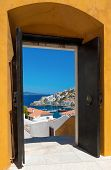 stock photo of hydra  - View of the port of the island of Hydra Greece as seen through an open door - JPG