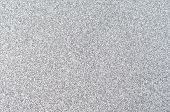 stock photo of sparkles  - Sparkling silver glitter texture background evenly spread across frame - JPG