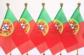 Portugal Flags Hanging On The Gold Flagstaff
