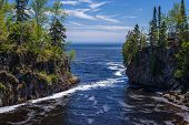 picture of temperance  - the foamy temperance river flows out into lake superior - JPG