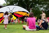 Mothers Watch Their Children Play At Butterfly Festival