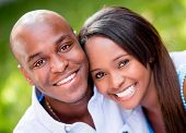 stock photo of bonding  - Beautiful portrait of a happy couple smiling outdoors - JPG