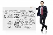 businessman in suit and business plan on white board
