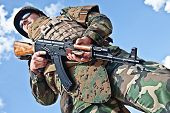 stock photo of akm  - soldier in bulletproof vest with ak - JPG