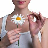 foto of guess  - Young girl guesses on a chamomile flower - JPG