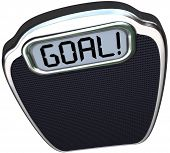 The word Goal on a scale to illustrate you have reached your target weight loss through diet and exe